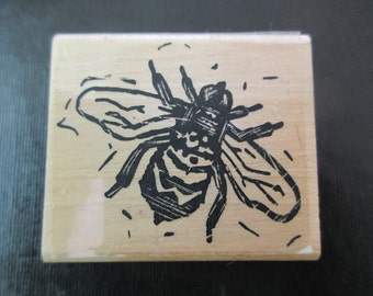 rubber stamp mounted on wood- flying bee, insect