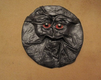 Grichels leather sew-on patch - black with red carousel horse eyes