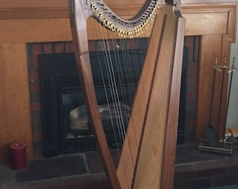 Used 31 String Gothic Harp In Walnut with Full Levers and Two Year Warrenty from the Builder