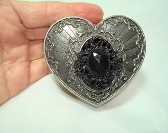 A 1993 HERITAGE PEWTER Pewter Heart Box with Southwestern Motif and Black Heart.