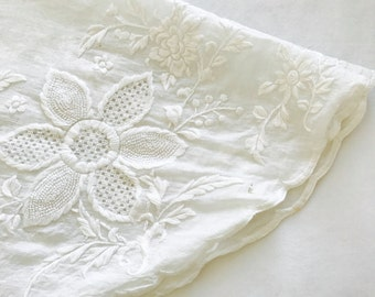 Vintage whitework doily with embroidered flowers