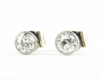 Old European Cut Diamonds, Platinum Bezel Set Diamond Stud Earrings. 0.52 ctw with Milgrain Beaded Edges.