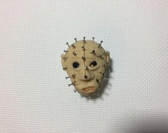 Pinhead needle minder (from the movie Hellraiser)