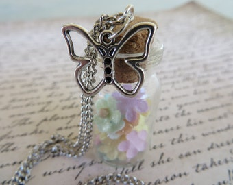 Glass Jar Pendant Necklace With Pastel Paper Flowers And A Silver Butterfly Charm