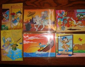 Set of Six scene changing Walt Disney Donald Duck Postcards