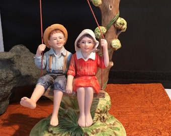 Norman Rockwell's summer fun collectible figurine.