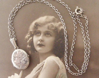 Vintage oval little sterling silver engraved locket and chain for a child