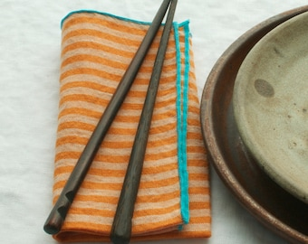 striped napkins  orange and white edged in turquoise 100% linen  set of four