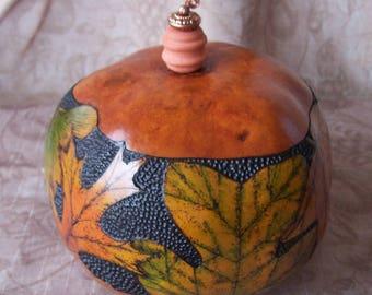 Medium Rust gourd box wood burned leaves.   1951
