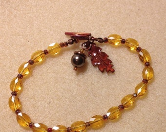Oak leaf and acorn charm bracelet with Swarovski crystal beads.