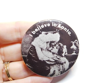 Vintage 1970s Risque Pin Pinback Button of Girl Kissing Santa That Reads I Believe in Santa DR21
