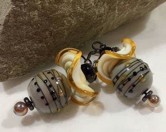 Lampwork glass round and ruffled disc beads make taupe, cream, yellow & black dangle earrings