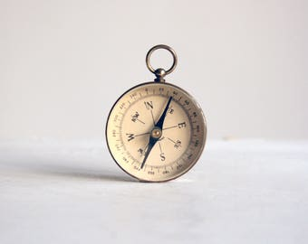 vintage brass pocket compass