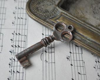 Antique rusty metal key.