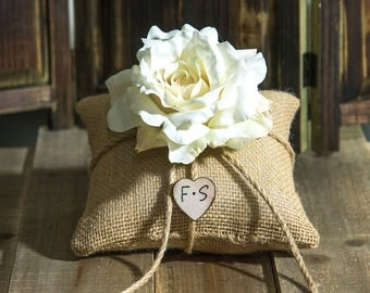 Burlap ring bearer pillow decorated with cream rose. Customize with flower and bride and groom initials