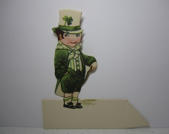 1920's unused die cut  St. Patrick's Day place card sweet little boy wearing  green a green suit with white top hat green clover,cane, pipe