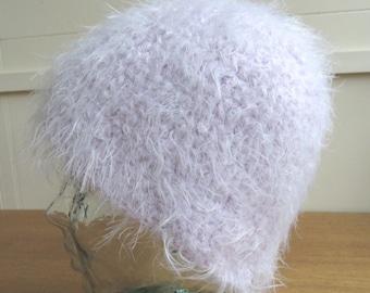 Crochet beanie hat in pink fluffy yarn