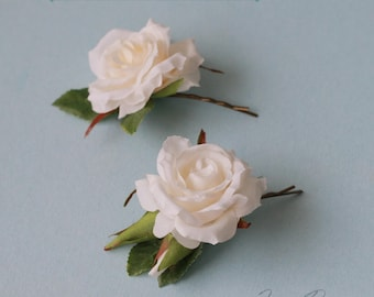 Small ivory roses blooming bobby pin set. Headpiece ivory flowers and green leaves