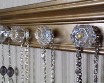 "Bronze gold Jewelry Organizer This necklace organizer has 4 large Clear knobs 12"" of Hanging storage & jewelery oranization."