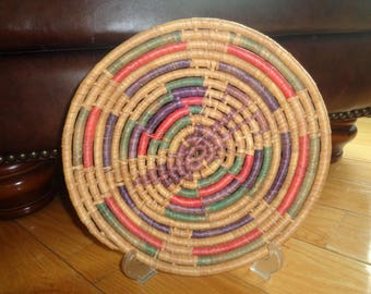 Retro Round Woven Basket made of colored sweet grasses wrapped around wooden reeds in Vintage Condition with wonderful well developed patina