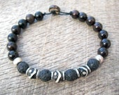 Mens surfer bracelet, dyed bone, black lava stone, metal and wood beads, on strong cord, toggle and loop clasp, tribal style, one of a kind