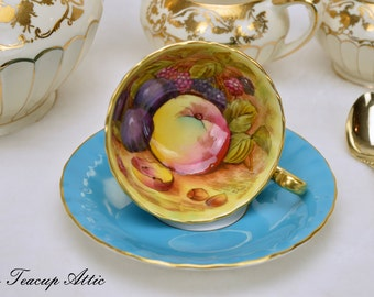 Aynsley Turquoise Oban Shaped Fruit Motif Teacup And Saucer Set Signed By The Artist, D. Jones, English Bone China Tea Cup Set, ca. 1952