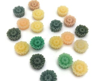 10  mixed color resin aster cabochons in cupcake style . Size is 7 mm x 16 mm
