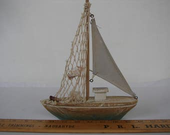 Vintage style, small wooden decorative yacht, sailing boat, shabby chic, nautical summer decor