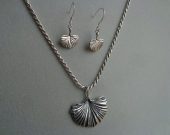 Silver pendant and earring set.