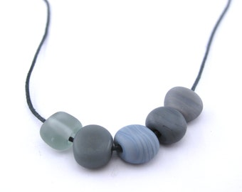 Beach pebble necklace - grey and blue -  80 cm long - handmade lampwork pebbles