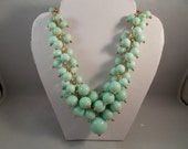 Turquoise Color Cluster Beads Bib Necklace on a Gold Tone Chain