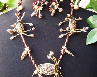 Carved Chinese Bead Necklace and Matching clip earrings