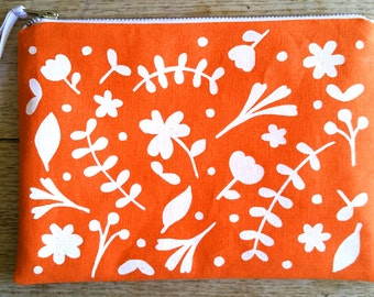Floral white on bright orange - cotton linen - flat zip pouch - screen printed and handmade