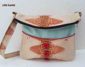 Sling in blue leather and printed leather python bag