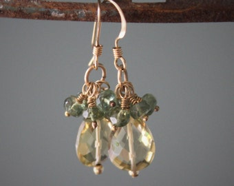 Stunning lemon topaz briolettes dangle beneath faceted green garnet rondelles on 14kt gold fill for the perfect earring!