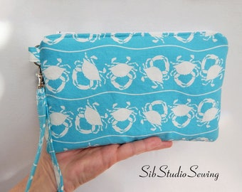 """Crabs Smartphone Clutch, 9 x 5.5 inches, Fits iPhone 6 & 7 Plus, Smartphone up to 7"""" Length, Pockets, White Crabs Phone Purse, Beach Purse"""
