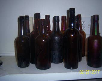 1890- 1940's Lot of 12 Amber liquor whiskey bottles 10  to  12  inches tall