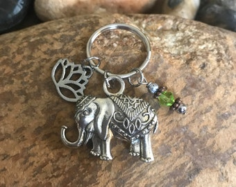 Silver elephant Keychain with a peridot crystal and a lotus charm