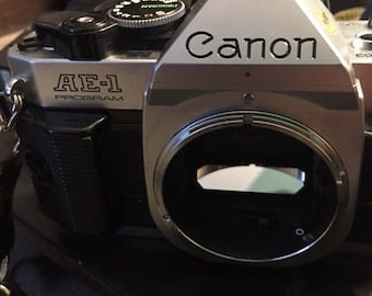 Vintage Canon 35mm camera and accessories..FREE SHIPPING !!