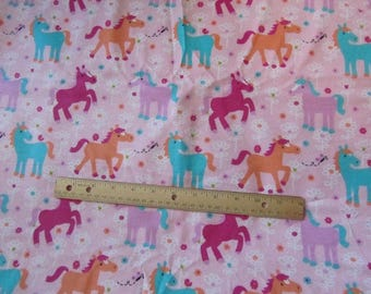 Pink with Multicolored Horses/Ponies Flannel Fabric by the Yard