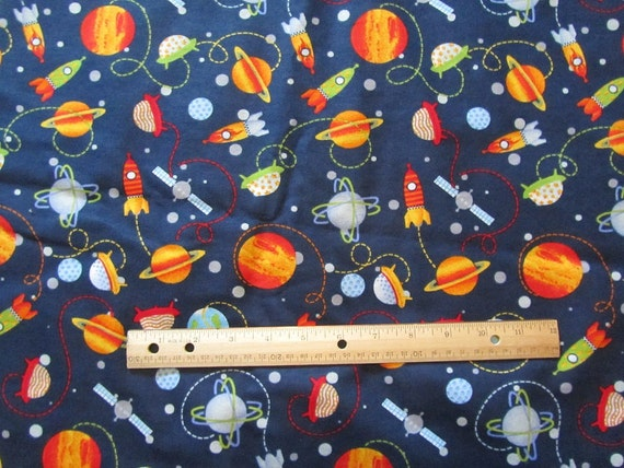 Navy blue rockets planets space flannel fabric by the yard for Space flannel fabric
