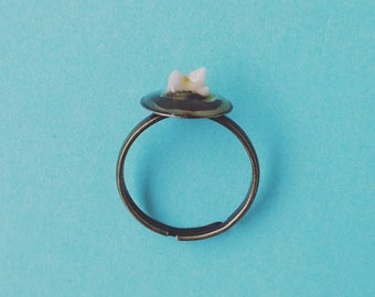 Naturally lost baby Cat kitten tooth on adjustable round setting bronze ring with resin coating