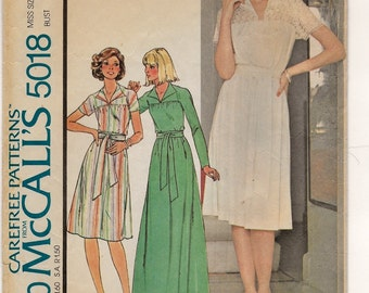 "A Floor or Below-Knee Length, Long or Short Sleeve, Yoked Flared A-Line Dress Sewing Pattern for Women: Size 12, Bust 34"" • McCall's 5018"