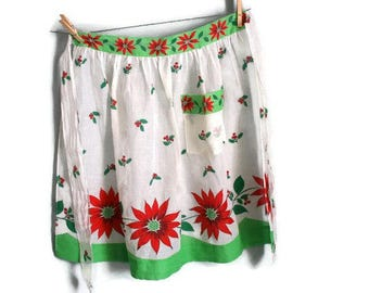 Vintage Christmas Half Apron printed with bright red poinsettias holly and berries