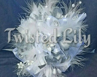 Feathers & Frills white wrist corsage