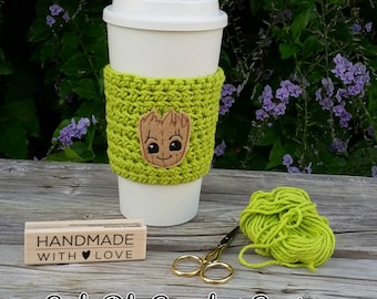 Crochet coffee cup cozy, with a cute Root feltie, made with 100% cotton. Crochet coffee sleeve, crochet coffee cozie