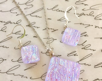 "Lavender with hints of pink dichroic glass set on 18"" nickel free chain. Hypoallergenic ear wires."