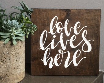 Love Lives Here. Wood Sign. Calligraphy