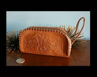 Vintage zip top tooled leather wallet.