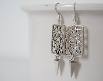 Cut Silver earrings.